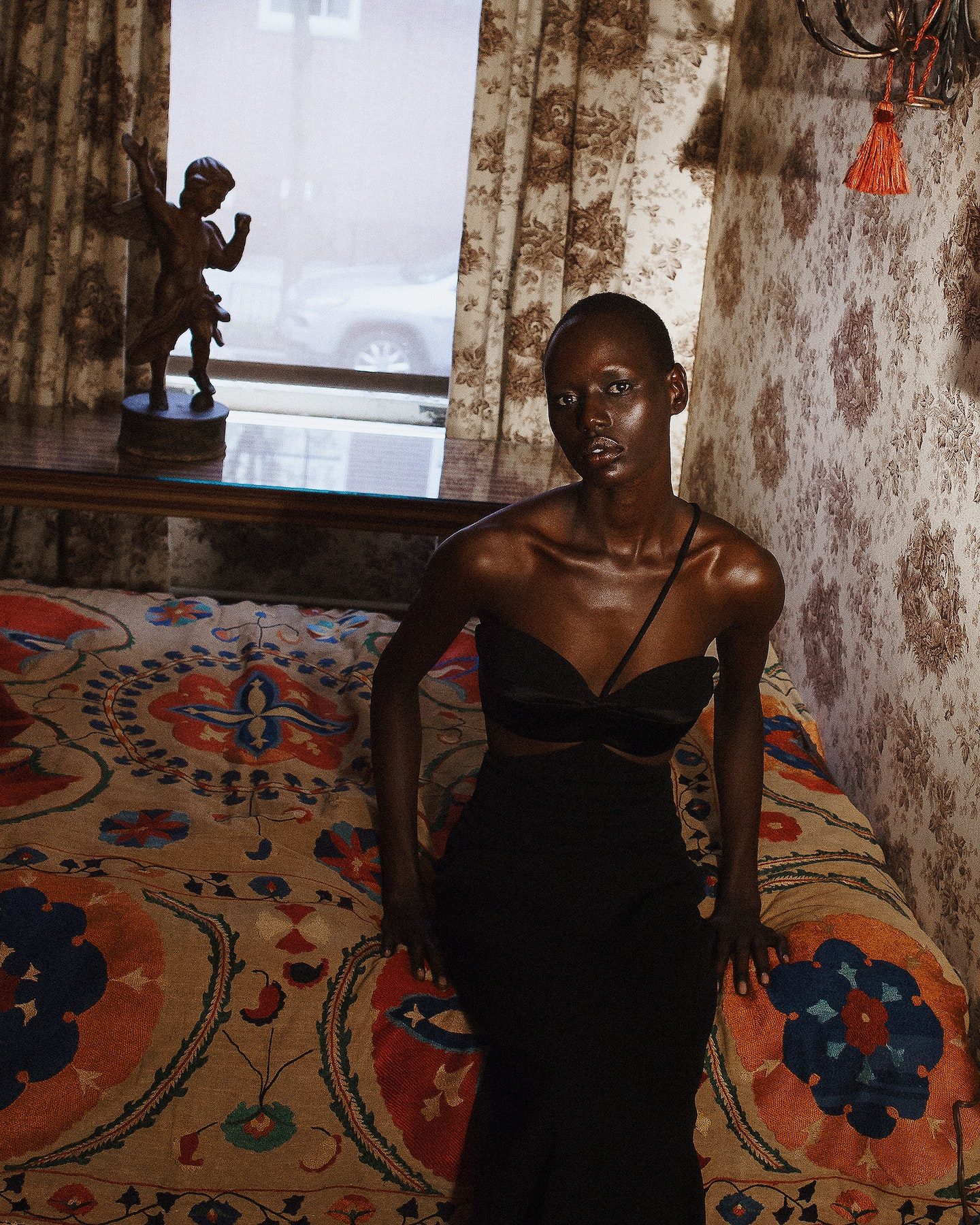 Ajak on the bed by Kacey Jeffers